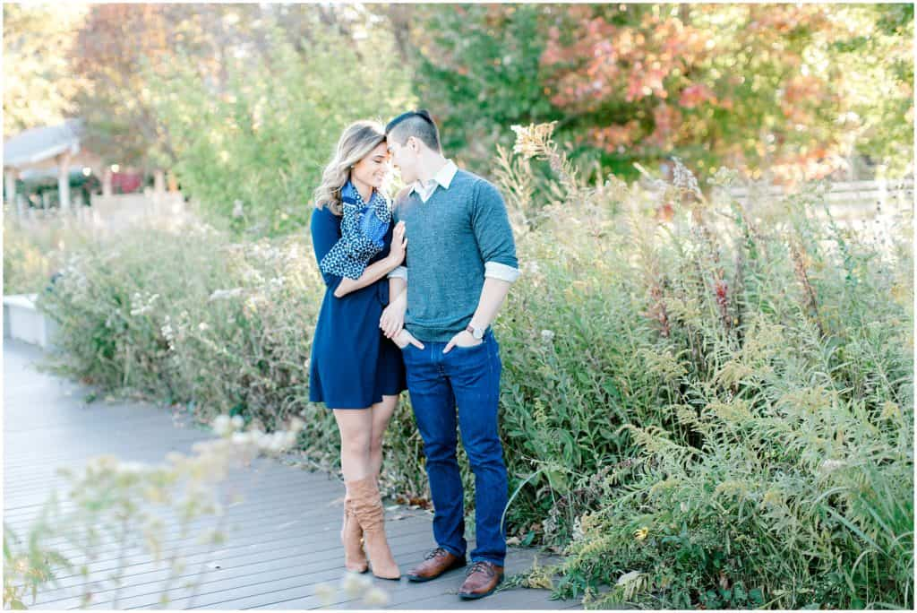 couple standing on the background of tall grass in Chicago Lincoln park during an engagement session by Bozena Voytko Photography