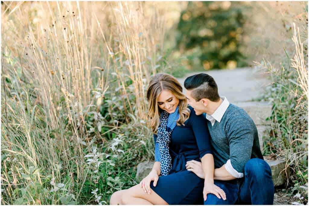 laughing couple on engagement session during sunset in Chicago Lincoln Park Zoo