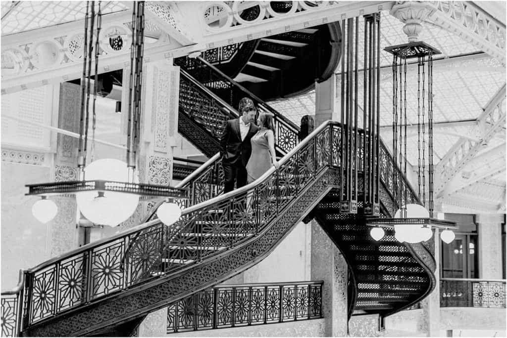 Rookery Building Engagement Session on the staircase black and white engagement session posing, great locations for engagement photos