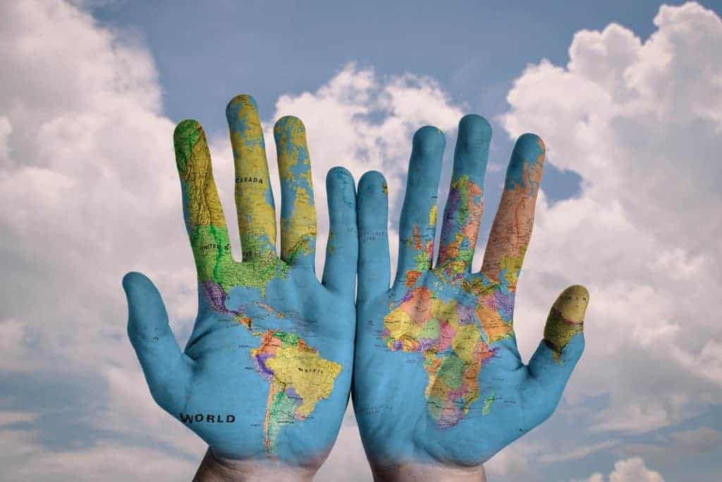 Hands with globe painted on