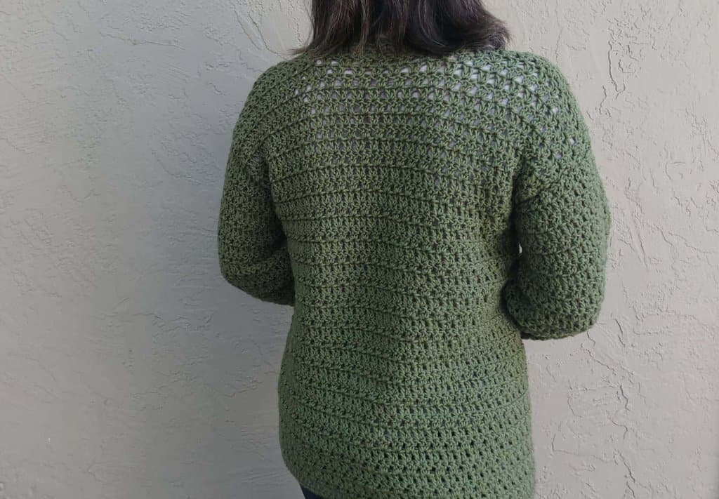Picture of woman in green cardigan crochet back