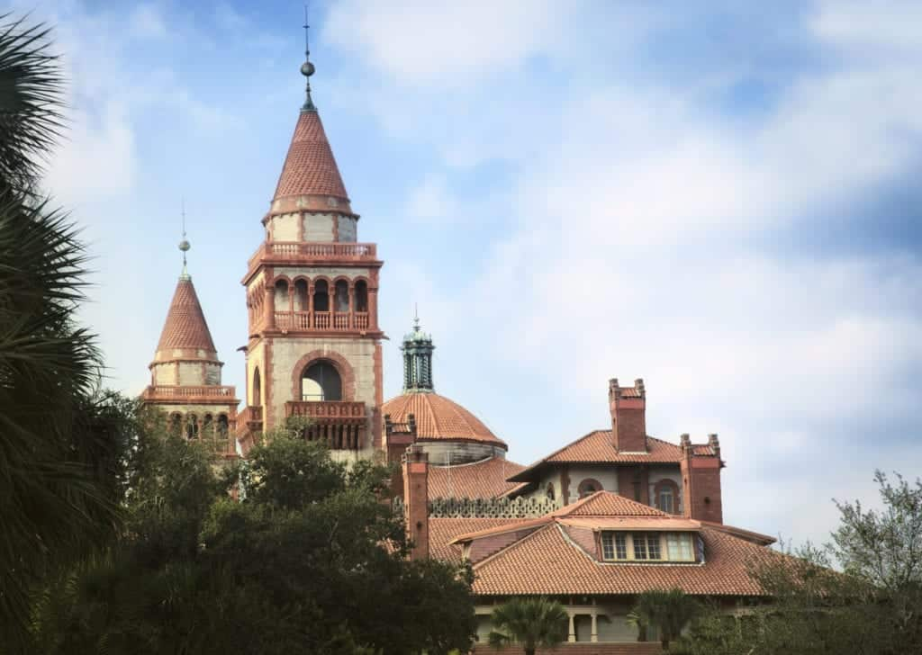 Spanish style towers and tiled roofs of historical St. Augustine building.
