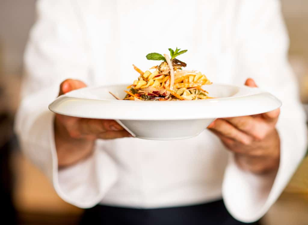 swot-analysis-for-restaurants-strengths Chef offering pasta salad to you