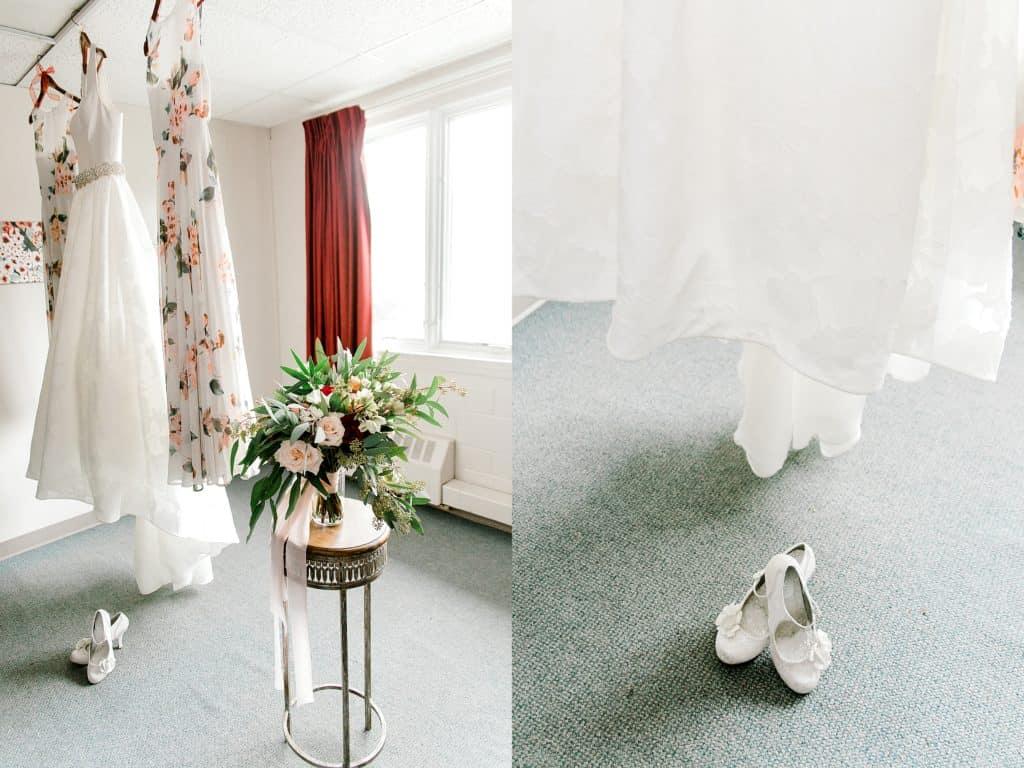 wedding dress hanging closeup on wedding shoes
