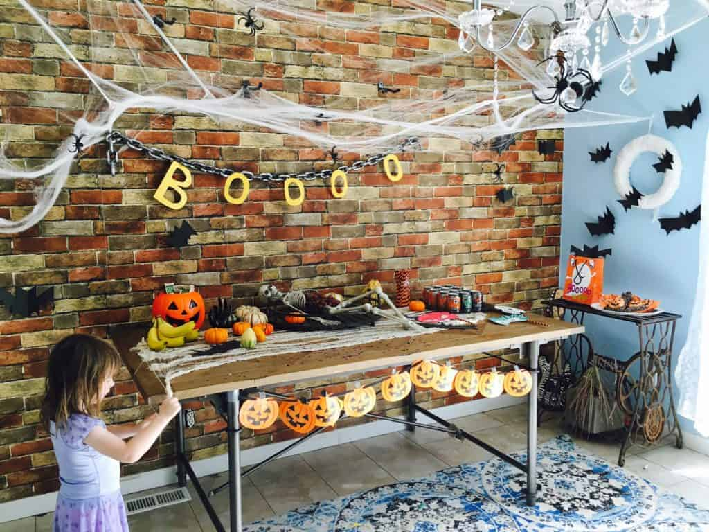 little girl playing at a halloween party