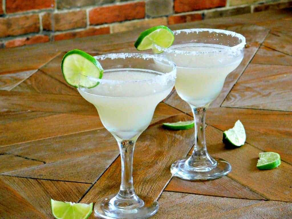 Lime Margaritas with lime on table