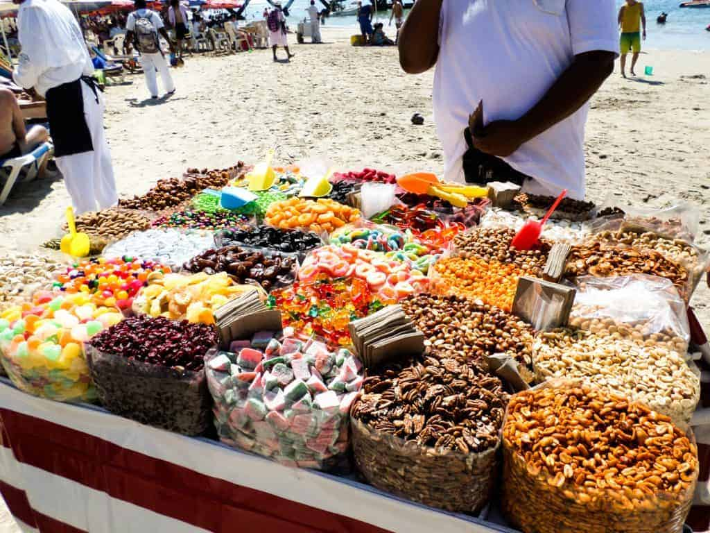Cart of bags of candy on the beach in Puerto Vallarta