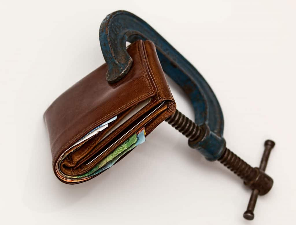 Photo of wallet in clamp insolvency solicitor Leicester
