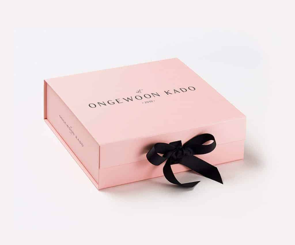 A pink box with a black bow