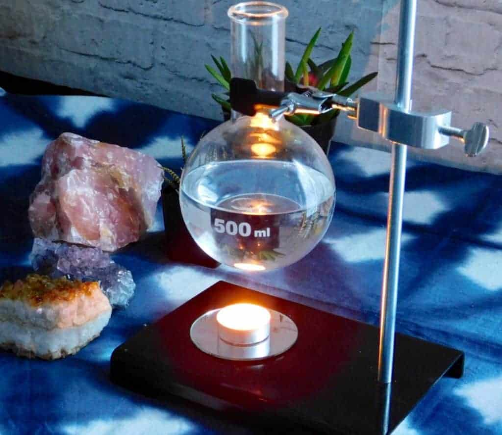 diy essentail oil warmer on table with crystals