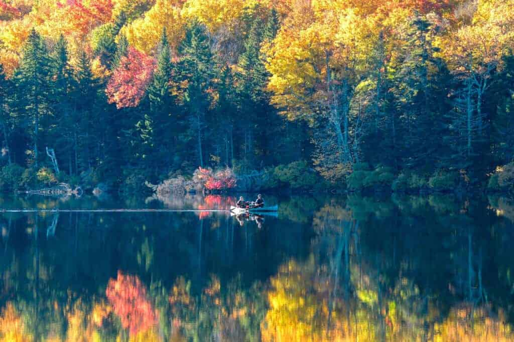 A fall foliage shot of Grout Pond in Vermont