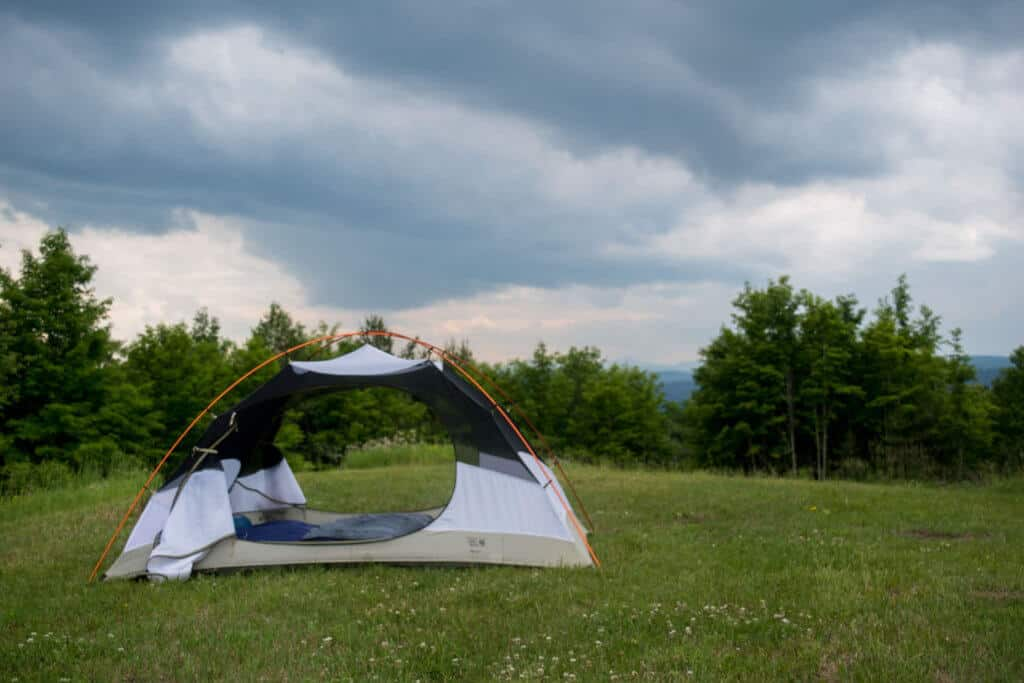 A small two-person tent perched on a hill in Vermont.