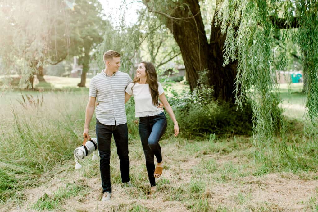 chicago engagement session couple walking on the grass