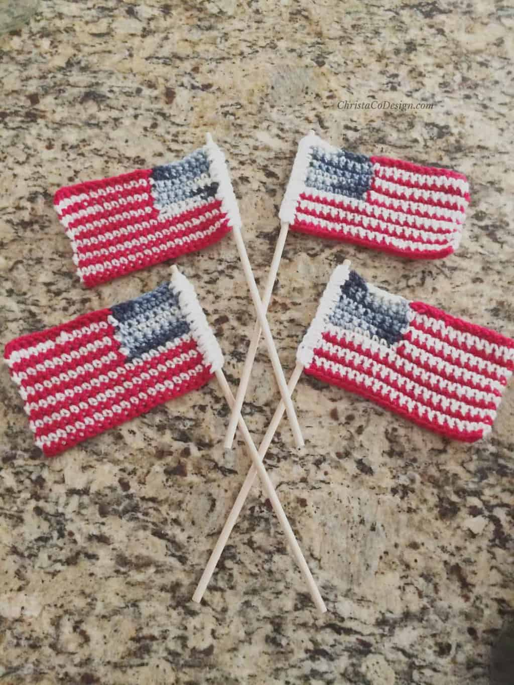 picture of 4 crochet flags on counter