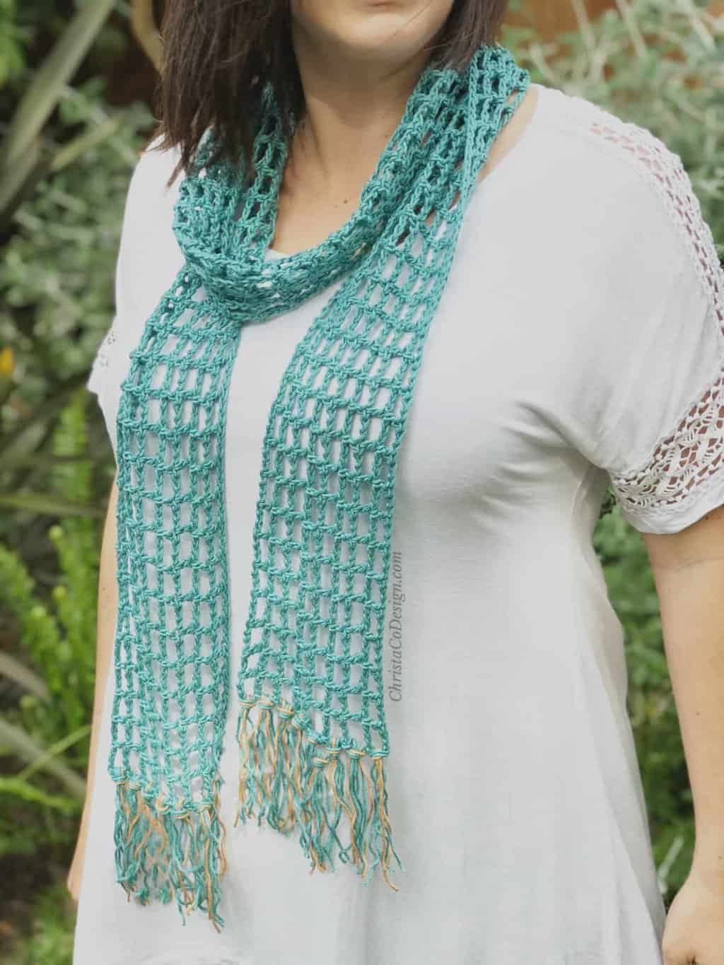 picture of woman wearing teal lace skinny summer scarf