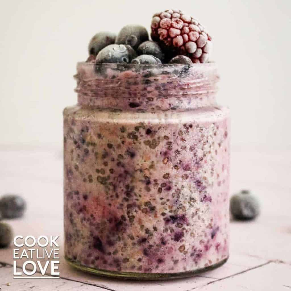 Front picture of berry overnight oats topped with frozen berries