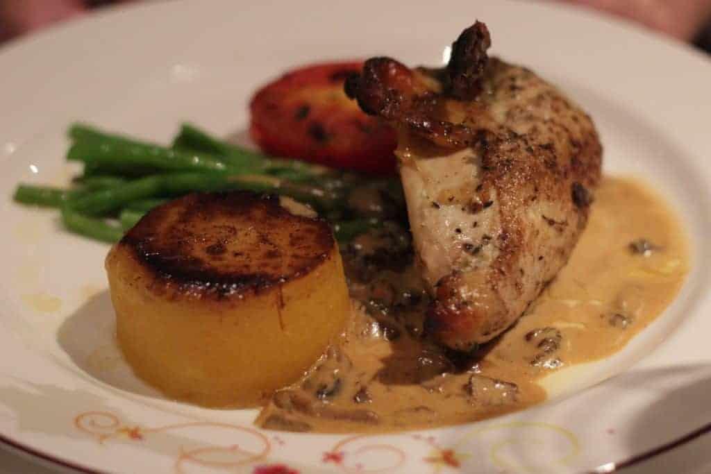 Roasted Thyme Marinated Chicken Breast with Fondant Potato, Haricot Vert and a Morel Mushroom-Cognac Sour Cream Sauce Rapunzel's Royal Table Seasons Menu Transatlantic Cruise Disney Magic