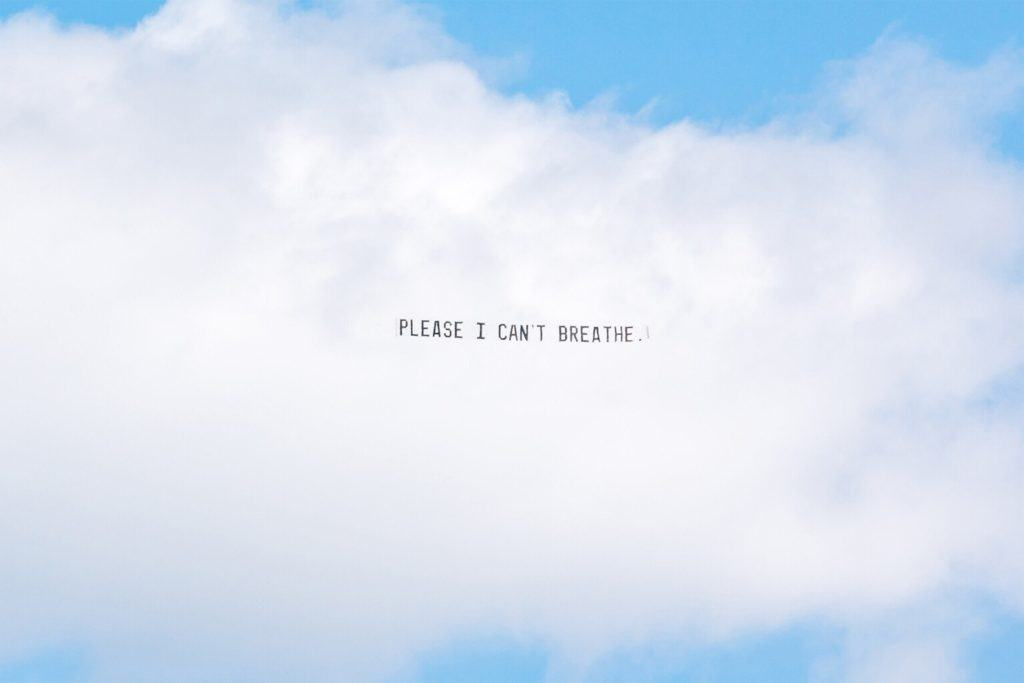 banner flying above Detroit, George Floyd Please I can't breathe