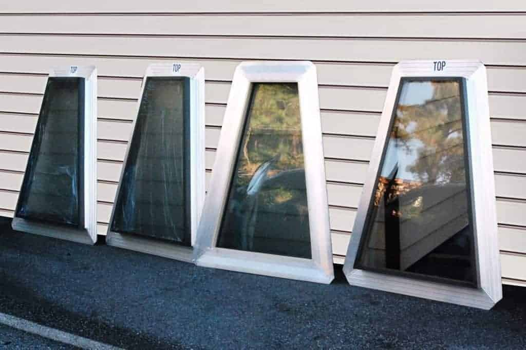 Four custom trapezoid shaped skylights ready for istallation
