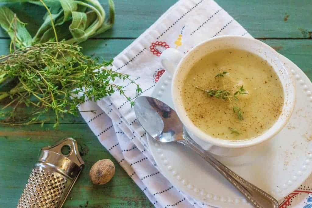 Creamy Turnip Potato Soup is turnip roots, Yukon Gold potatoes, sweet onions, garlic, and herbs stewed in butter with added chicken stock and served with a light grating of fresh nutmeg.