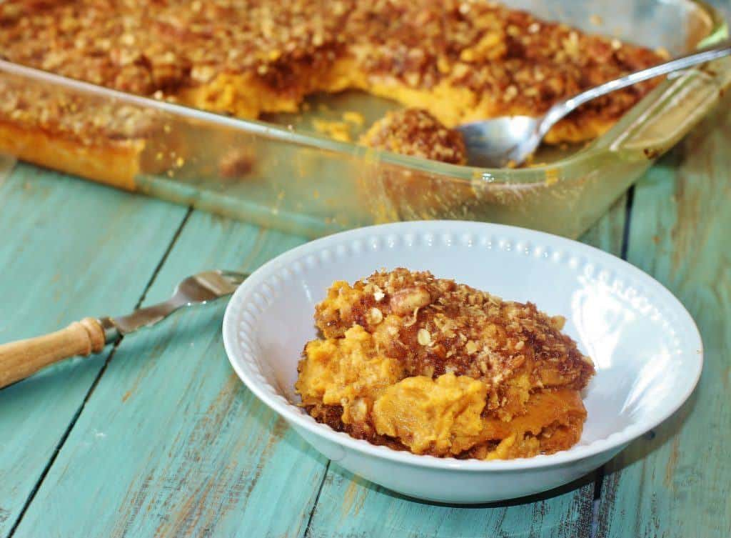 Sweet Potato Casserole. A Thanksgiving tradition. Sweet potatoes are mashed, sweetened and flavored with spices then topped with an oatmeal