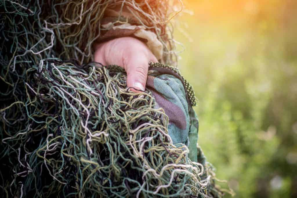 threads on a camouflaged suit