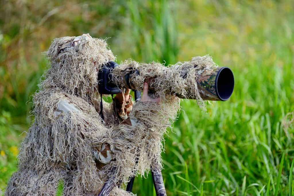 Camouflage wildlife photographer