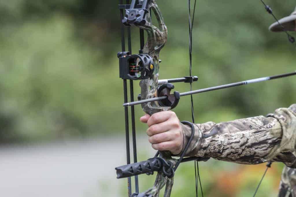 arrow going through a bow