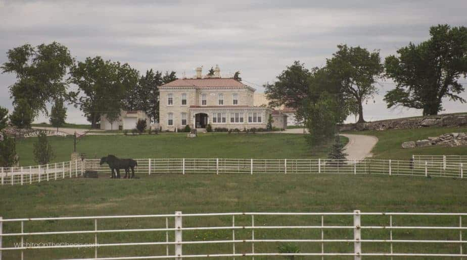 Kansas B&B: Clover Cliff Ranch, with two horses grazing in the pasture in front of the house