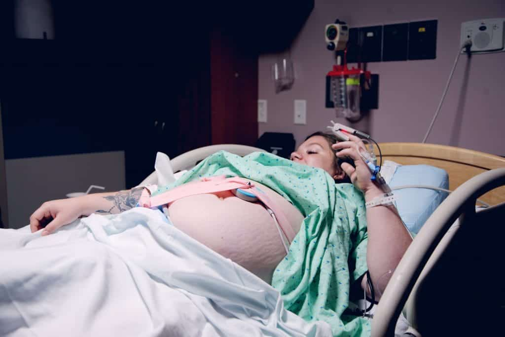 Woman laboring in hospital on back can increase pain during labor and childbirth.