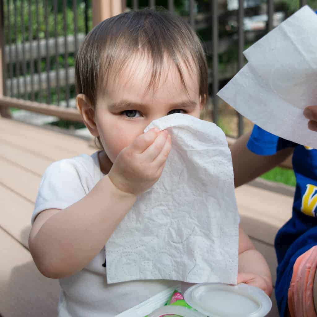toddler using kleenex wet wipes