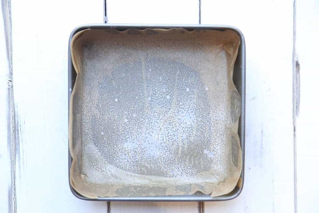 A square tin lined with baking paper