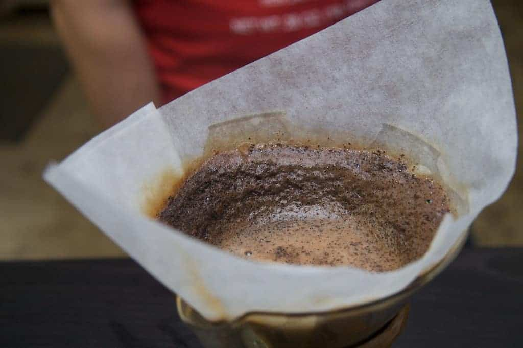 Closeup of a Chemex filter with pour-over coffee brewing