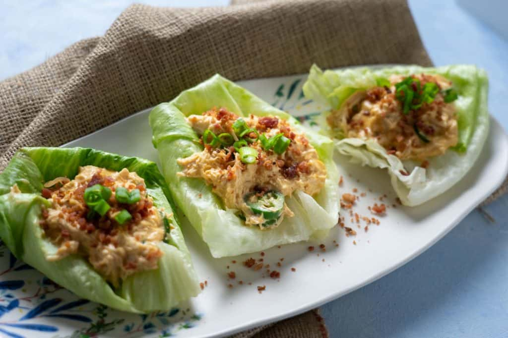 Three Crack Chicken Lettuce Wraps laid out on a plate