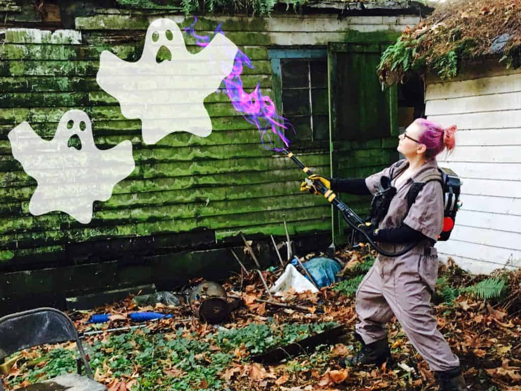 woman in ghostbuster costume shooting ghosts