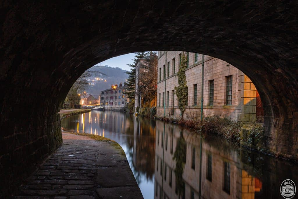 Looking through Station Road bridge, with the mills reflection in the canal.