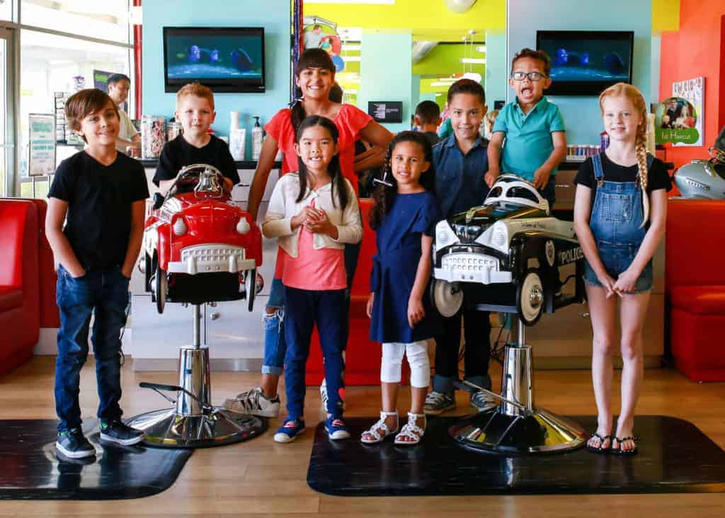 another group shot of happy kids at pigtails & crewcuts children's hair salon franchise