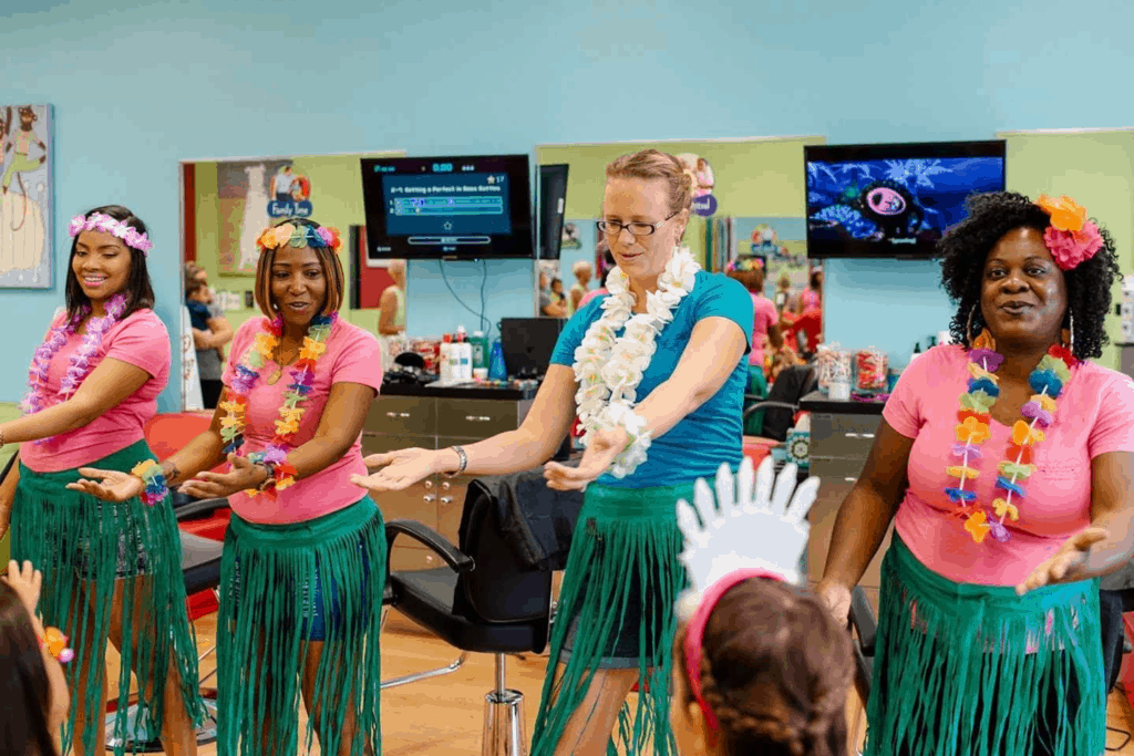 Bobbei Ruswinckel, children's hair salon franchise owner, with stylists dressed in hula dresses