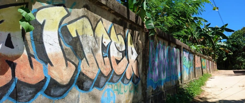 Big wall with colorful graffiti paintings in Sorong - Things to do in Sorong