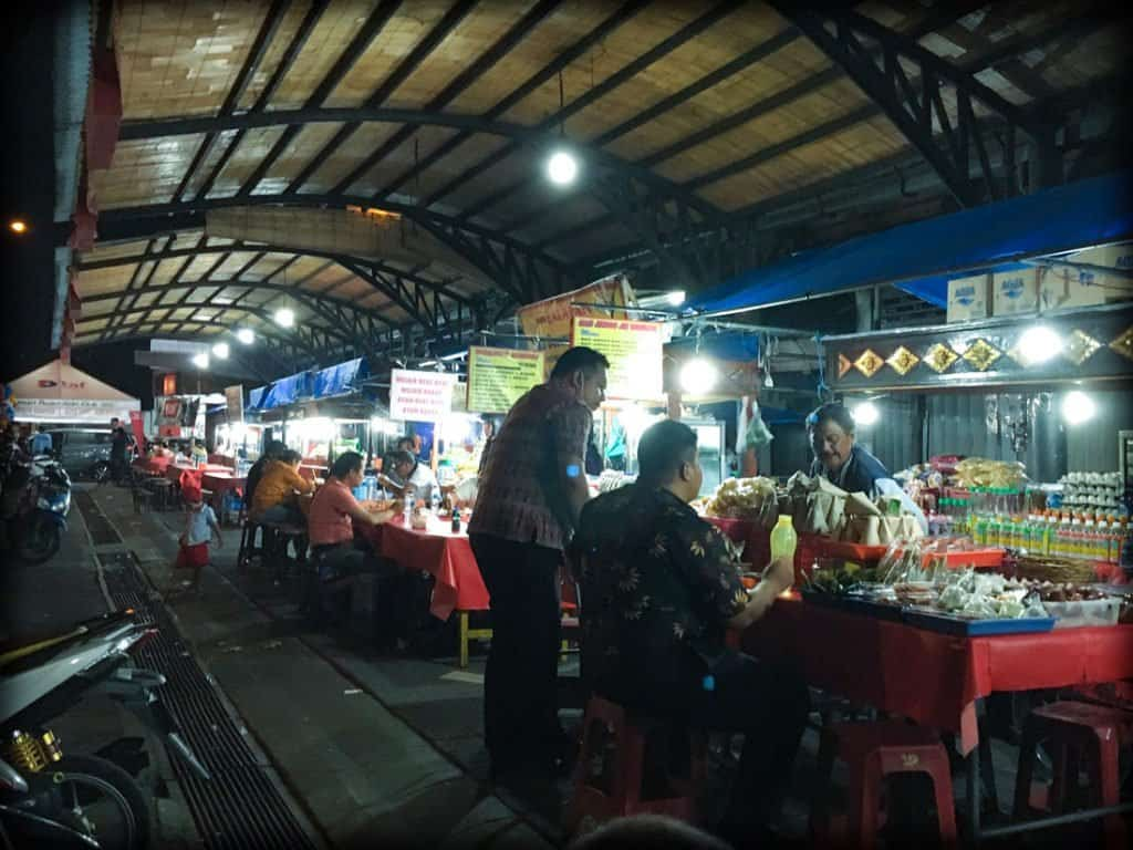 People eating at food stalls at a Bali night market in Gianyar, Indonesia