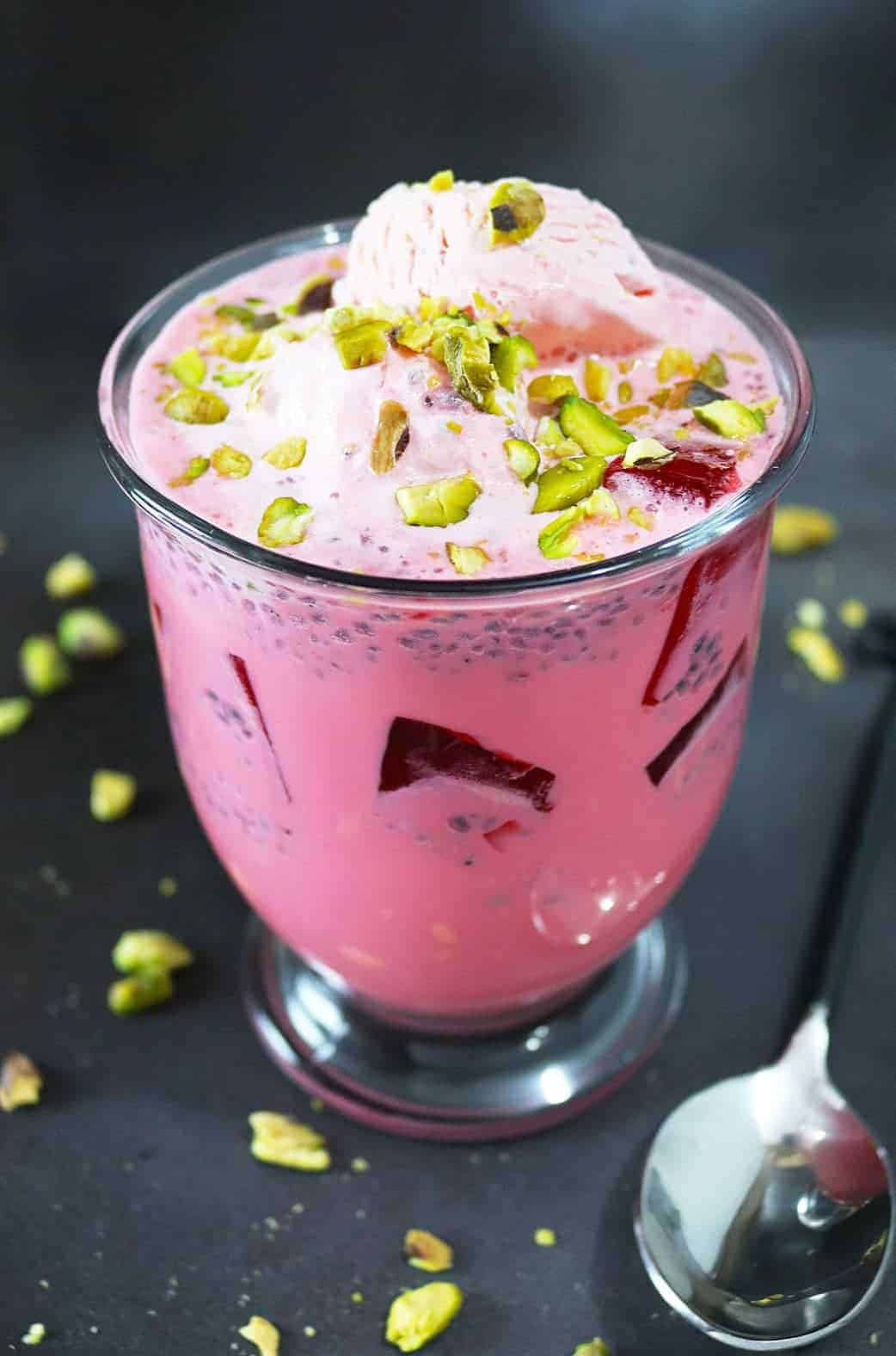 Falooda - A cool and delicious rose water and rose syrup beverage with basil seeds, tapioca pearls and almond extract, served with ice cream it will become a summer favorite