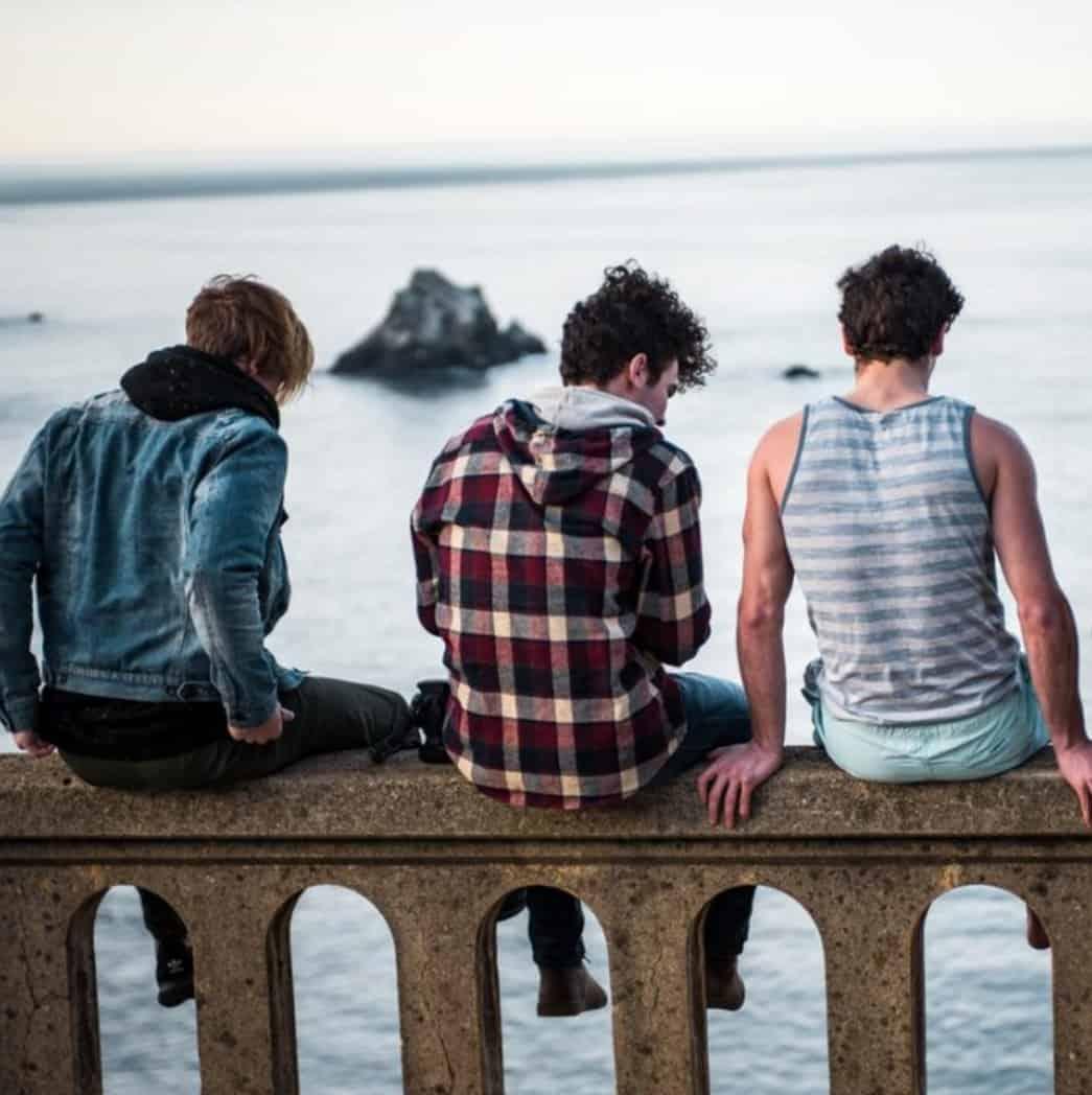 Teen boys on a sea wall