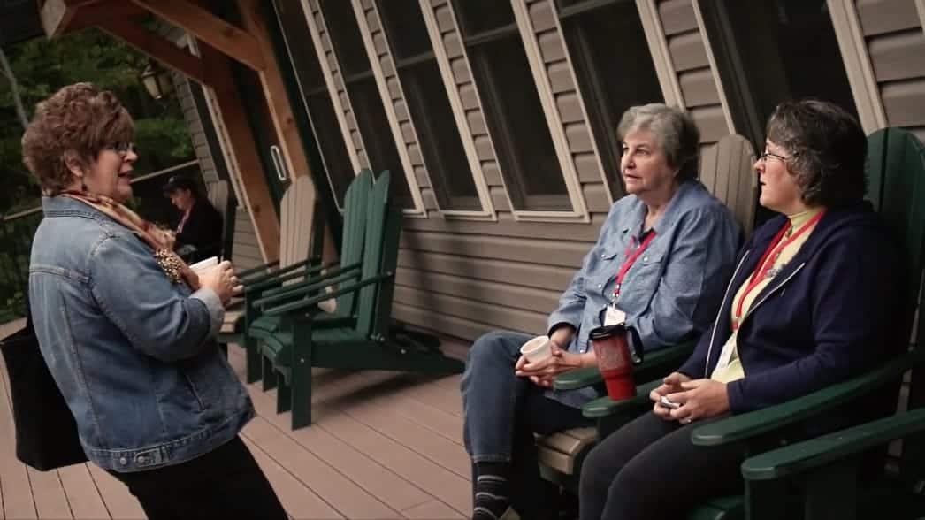 Women sitting on a deck