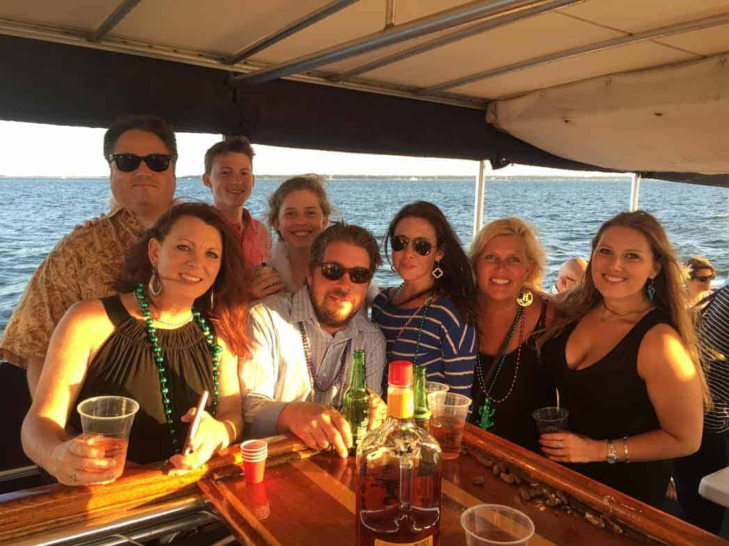 Group of people enjoying drinks at the bar. Private charter boat Charleston SC