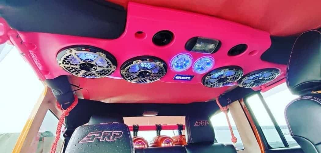 speakers in sound bar inside red jeep wrangler