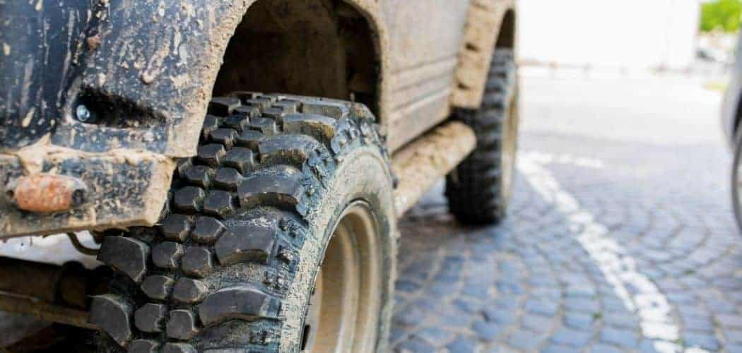 tires with mud of a Jeep Wrangler
