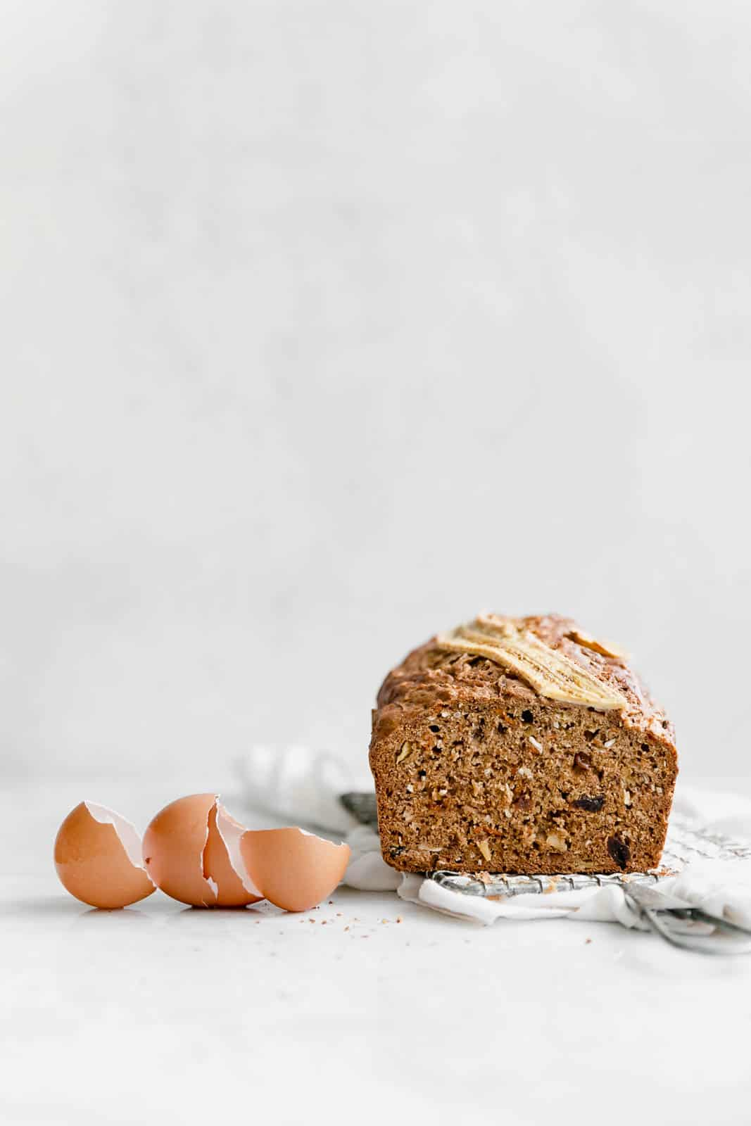 A super moist Carrot Cake Banana Bread made with coconut, carrots, cinnamon, and banana. Perfect for breakfast, snack, or dessert!