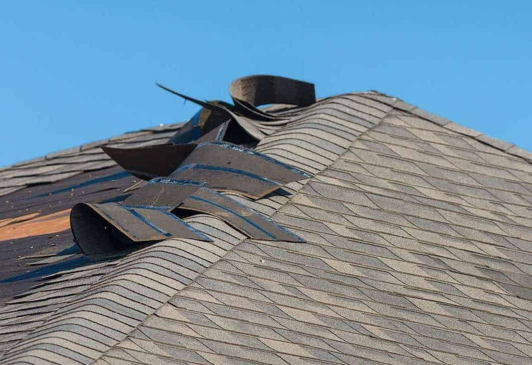 Home Roof With Wind Damage to Shingles