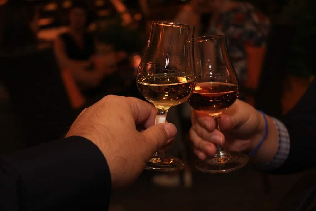 white wine drinking couple night