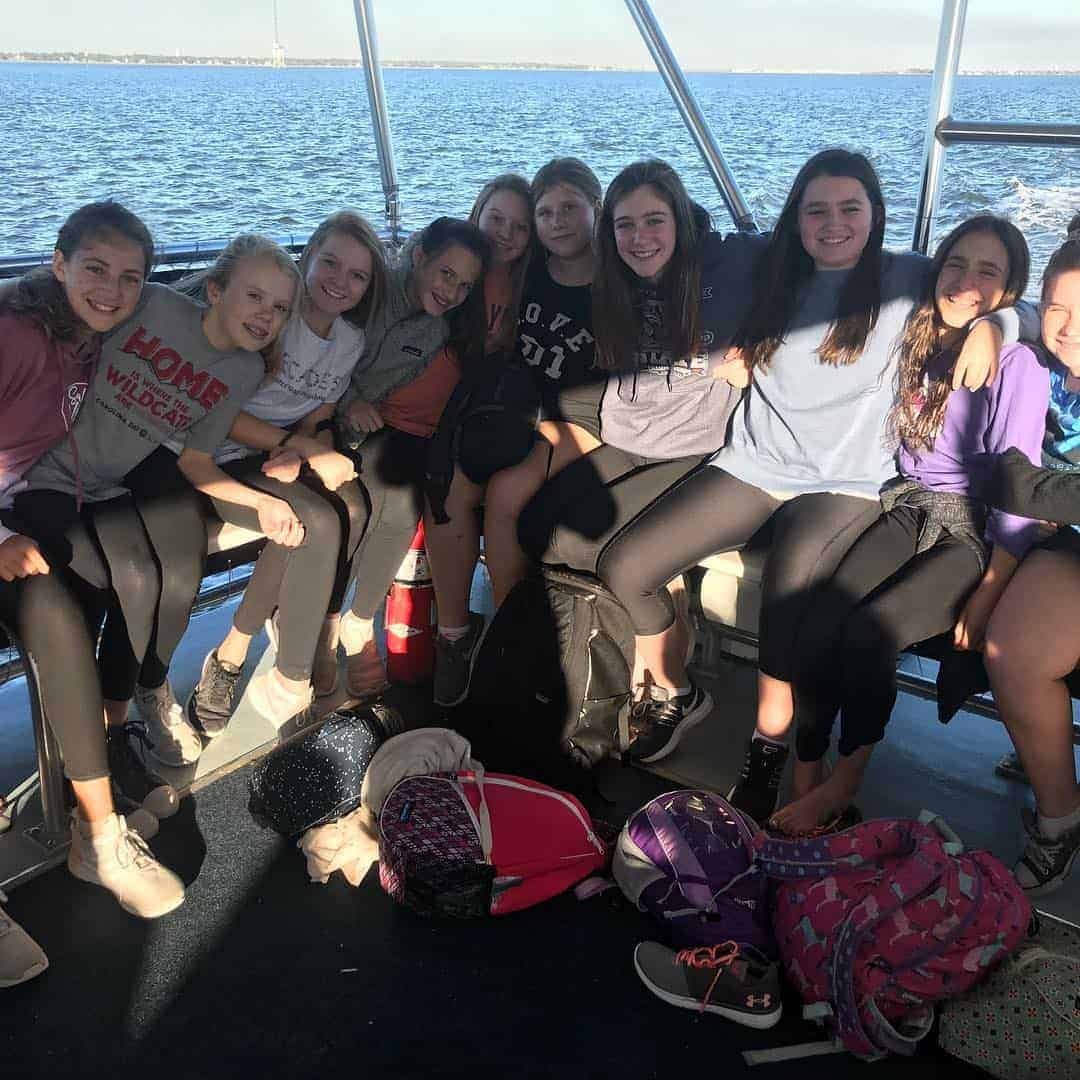 Group of young girls smiling on the boat. Best boat tours in Charleston, SC
